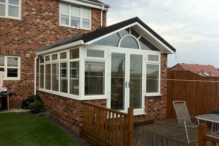 Tiled conservatory installed to replace old plastic conservatory roof