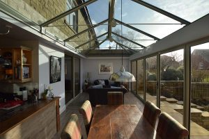 Orangery internal view with glass roof and bifold doors